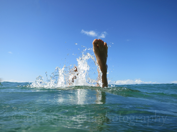 feet diving into ocean