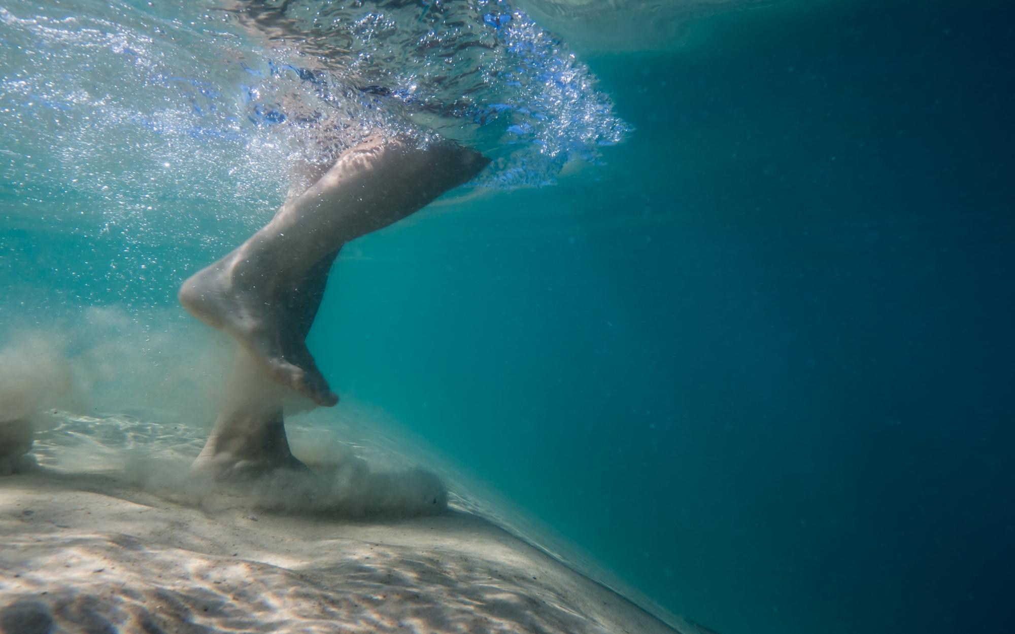 running underwater with fish