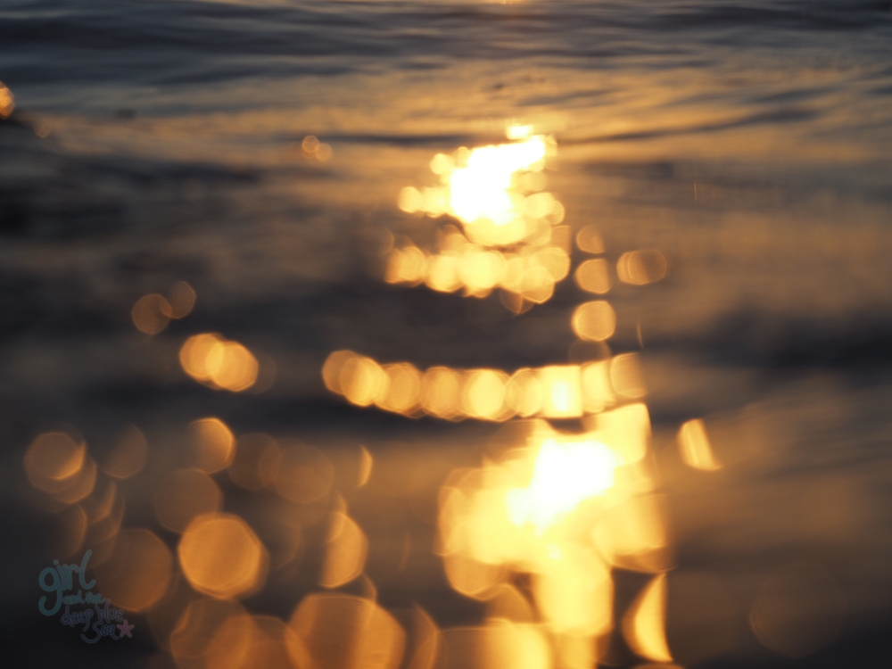 abstract golden light on ocean water